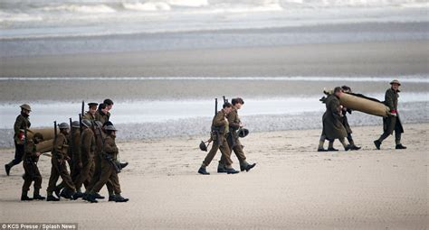 film dunkirk evacuation soldiers and warships line the beach to film harry styles