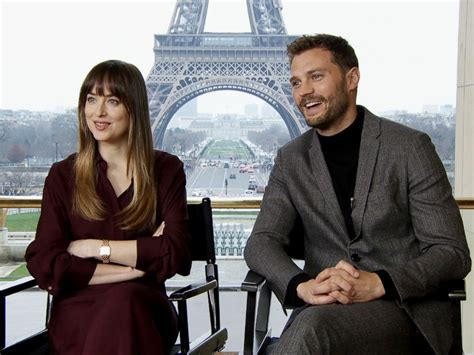dakota johnson and jamie dornan huddle up for fifty shades dakota johnson says fifty shades freed is about being