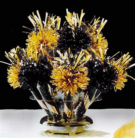 wanderful centerpieces and favors black and gold