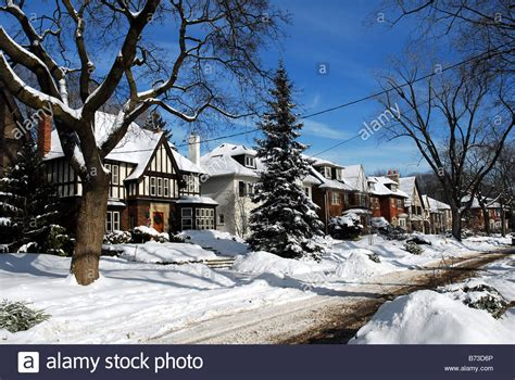 buying a house in usa from canada suburban street with snowy houses canada or united states stock photo royalty free