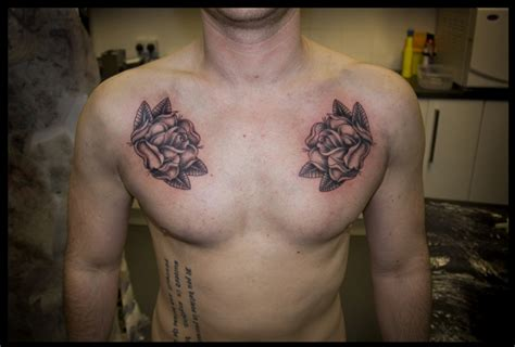black and grey chest tattoos roses chest tippingtattoo