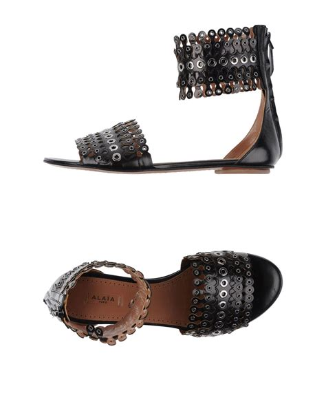 alaia sandals ala 239 a sandals in black lyst