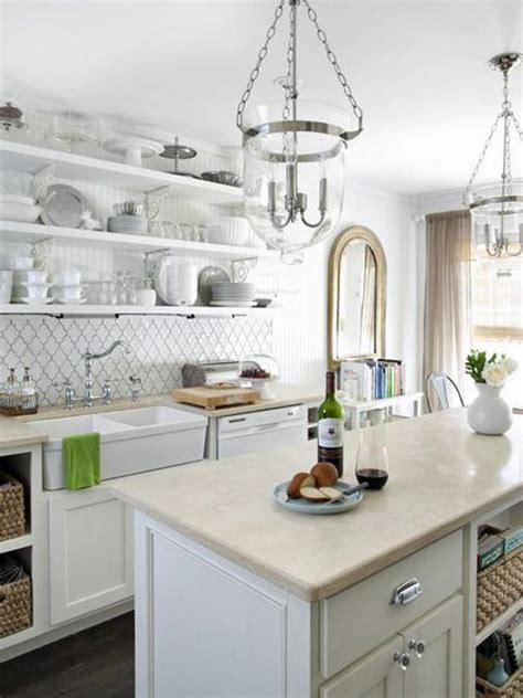 White cottage kitchen with island and open shelving