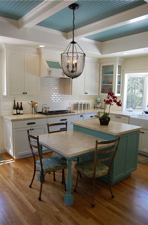 white kitchen island table the painted beadboard ceiling and chicken wire light