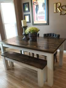 Image of solid wood kitchen table with bench and large ceramic candle