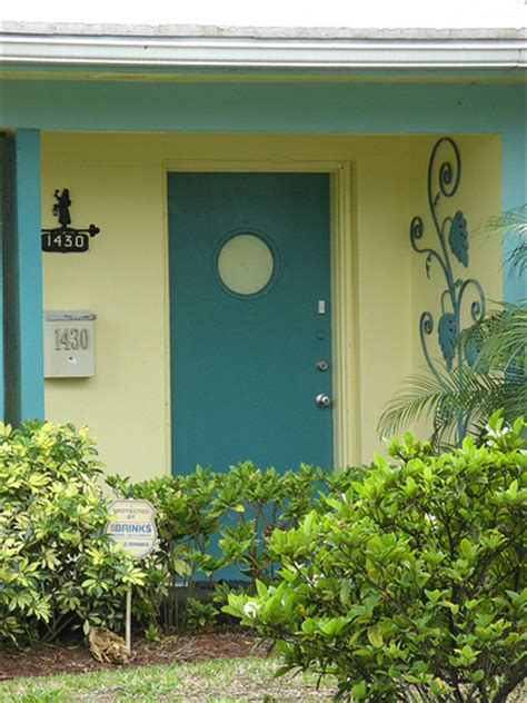 yellow house with blue door blue door yellow house vintage tropical