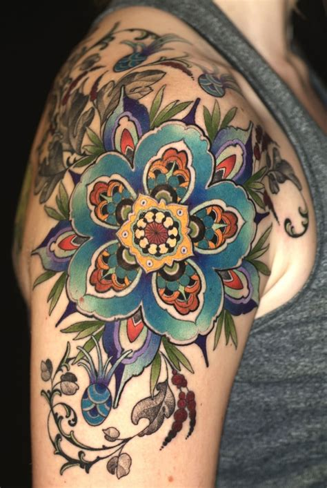 traditional shoulder tattoo colorful traditional flower on right back shoulder