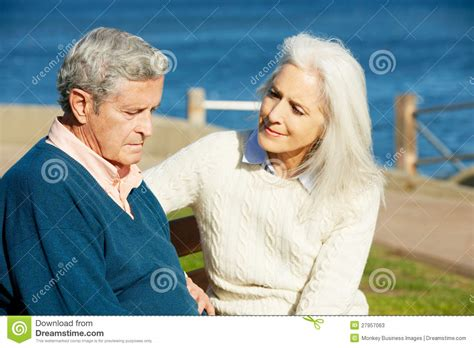 comforting someone with depression senior woman comforting depressed husband stock photos