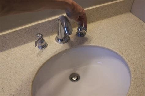 remove and install a bathroom faucet