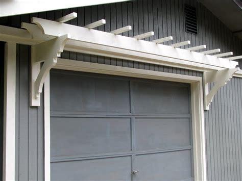 Blue Roof Cabin Diy Trellis Over The Garage Door Trellis Garage Door