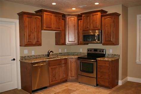 basement kitchen cabinets corner basement mini kitchen design ideas with small l shape brown kitchen cabinet and marble