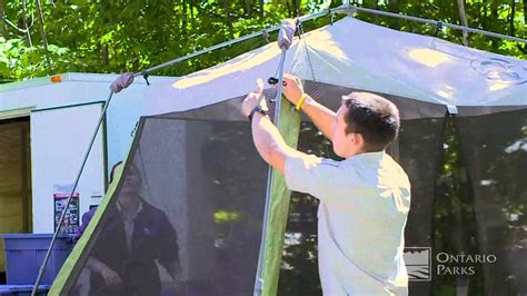 instant up screen house with awnings cing tips from ontario parks setting up a coleman