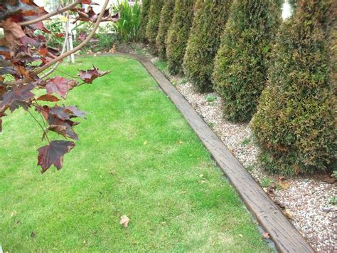 Using Landscape Timbers To Border A Driveway Exles Of Our Previous Lawn Edging Driveway Edging And