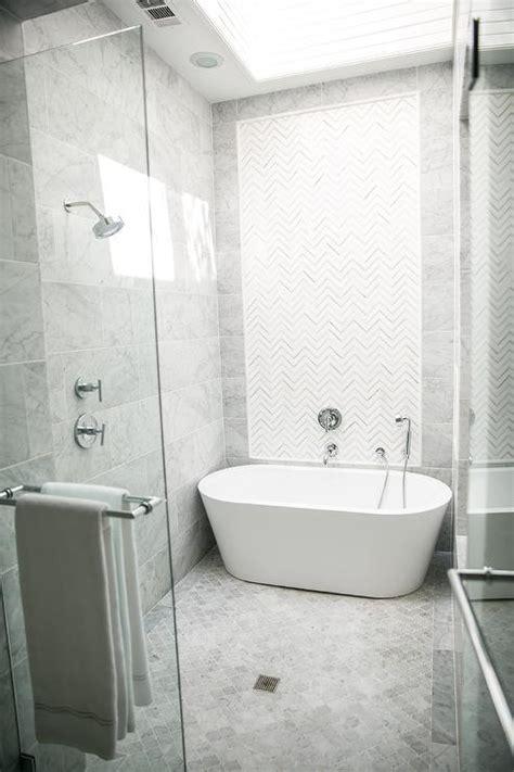 white  gray marble chevron inset shower tiles