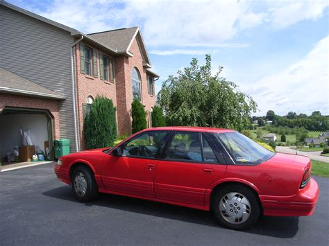 file 1995 oldsmobile cutlass supreme red jpg wikimedia commons