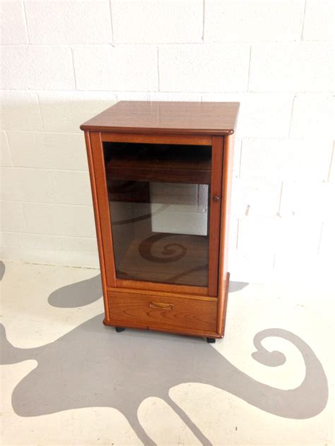 mid century modern stereo cabinet in teak with glass door and