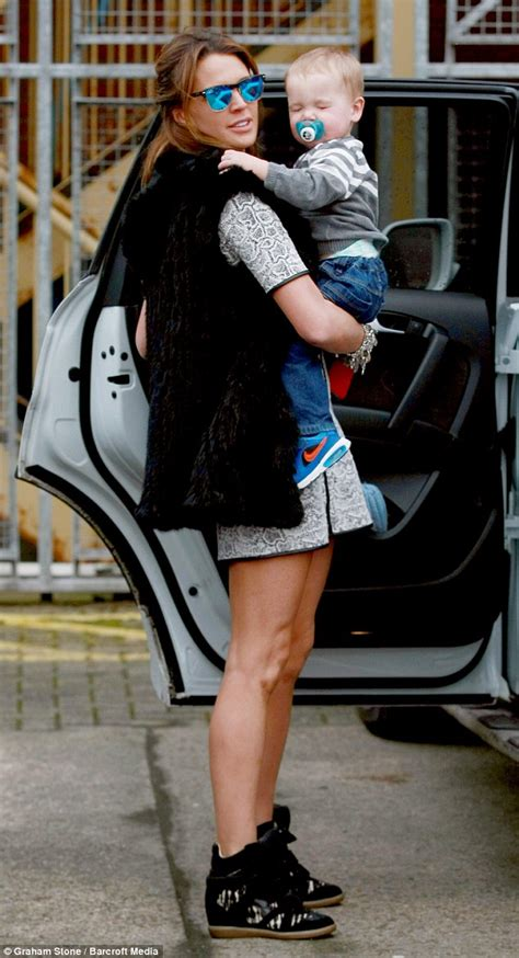 Gw Sweater Leopard danielle lloyd cradles while running errands in animal print dress daily mail