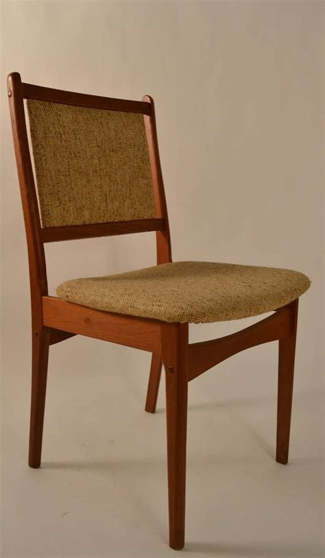 modern set of six teak dining chairs for sale at