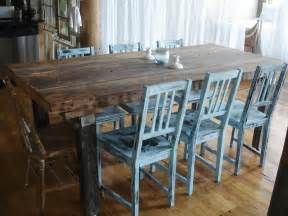 Dan faires added blue distressed chairs to a rustic wood dining table