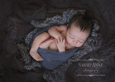 Flokati Rug Newborn Photography by Newborn Boy In Gray Flokati Rug With Layers And Wrap