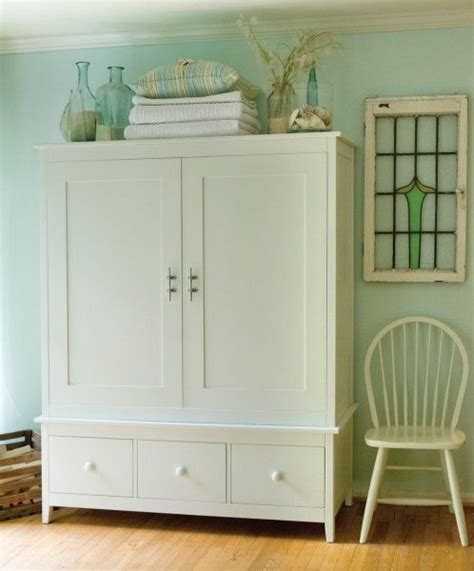 Decorating Armoire Tops by 25 Best Ideas About Armoire Decorating On