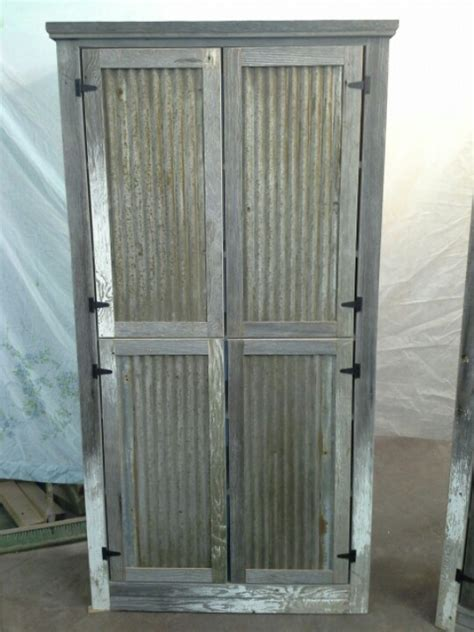 kitchen cabinets with tin inserts barnwood cabinet tin barn roofing for door panels
