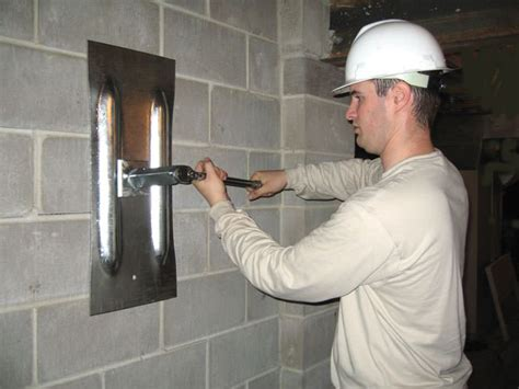 basement wall anchor systems bowing foundation wall repairs in michigan buckling