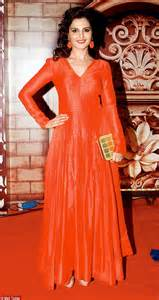 Monica bedi looks stunning in a floor length red gown and matching
