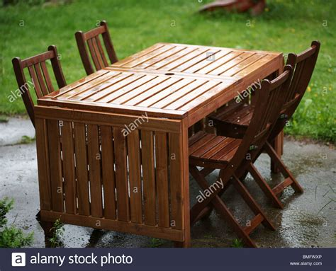Wooden Patio Table And Chairs Garden Furniture Wooden Table And Chairs Stock Photo Royalty Free Image 29853118 Alamy