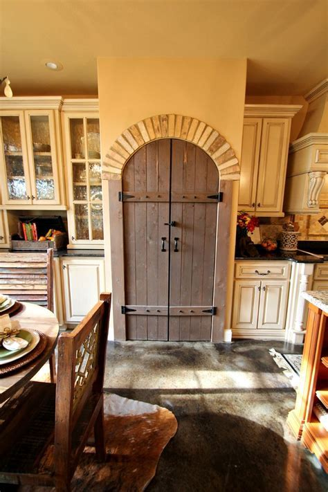 Arched Pantry Door with Brick Accents, Distressed Cabinets