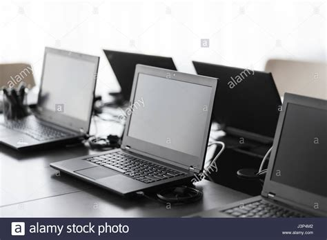 modern conference room with furniture laptops big