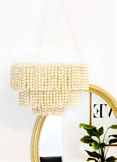 diy beaded chandelier tutorial this diy wood bead chandelier click for tutorial