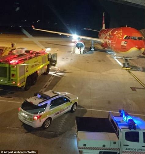 airasia flight to malaysia lands in melbourne as pilot airasia flight makes emergency landing within brisbane