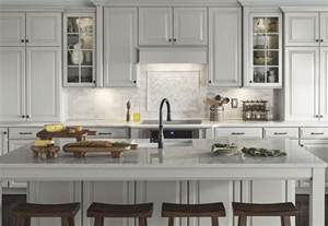 Trends In Kitchen Backsplashes marble subway with herringbone inlay