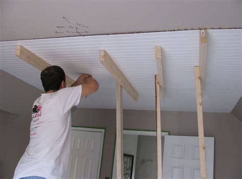 installing beadboard sheets interior worker installing beadboard ceiling panels