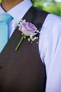 groom s boutonniere boots through the lens