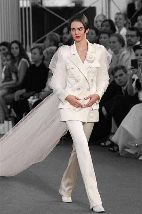 cara delevingne white suit kendall jenner steals the veil from cara delevingne at chanel