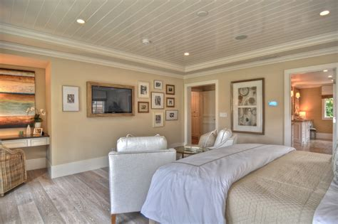 white washed oak flooring Bedroom Traditional with baseboards Beach house interior