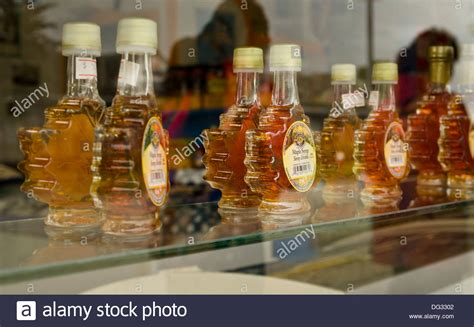 Shelf Of Maple Syrup by Maple Leaf Shaped Jars Of Maple Syrup Sitting On A Shelf