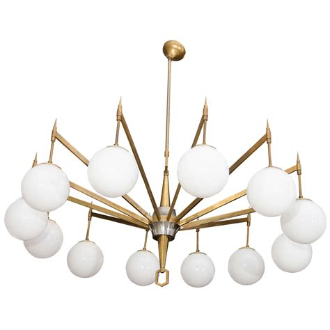 12 light chandelier brass 12 arm brass chandelier with white opaque globes for sale