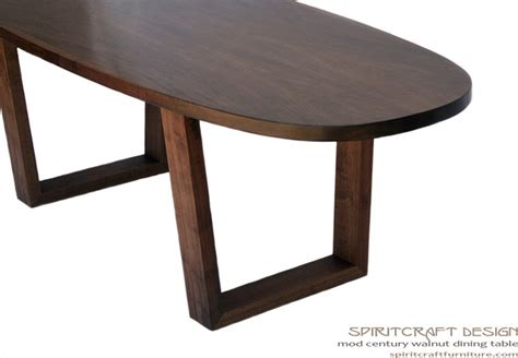 the mod century oval dining table in walnut contemporary
