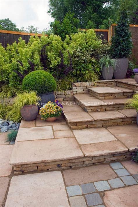 patio with mixed paving materials backyard