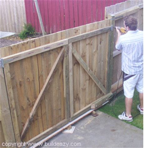 how to build a double swing wooden gate building lumber double gates page 1