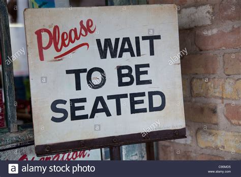 wait to be seated sign wait to be seated sign stock photo royalty free