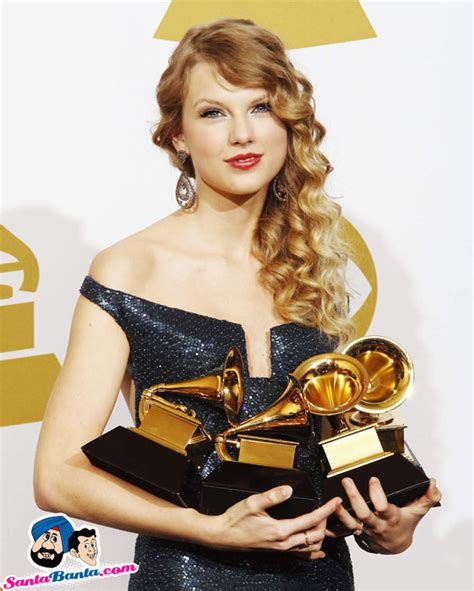 taylor swift global awards taylor swift holds her four grammy awards at the 52nd