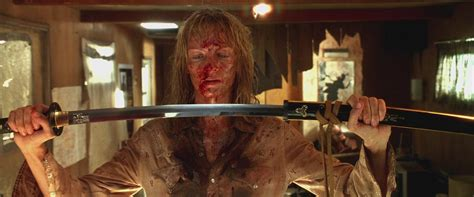 in kill bill why does umas hair go from short to long balls of steel realistic writing goals minus the punching bag