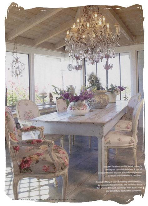 gorgeous shabby chic dining room chandelier gorgeous floral fabric on the chairs and the