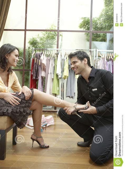shop assistant trying shoe stock image image of feminine 25466913
