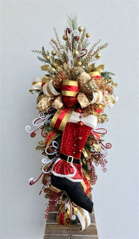 Arcadia Floral And Home Decor by Christmas Santa Boot Door Swag Designed By Arcadia Floral