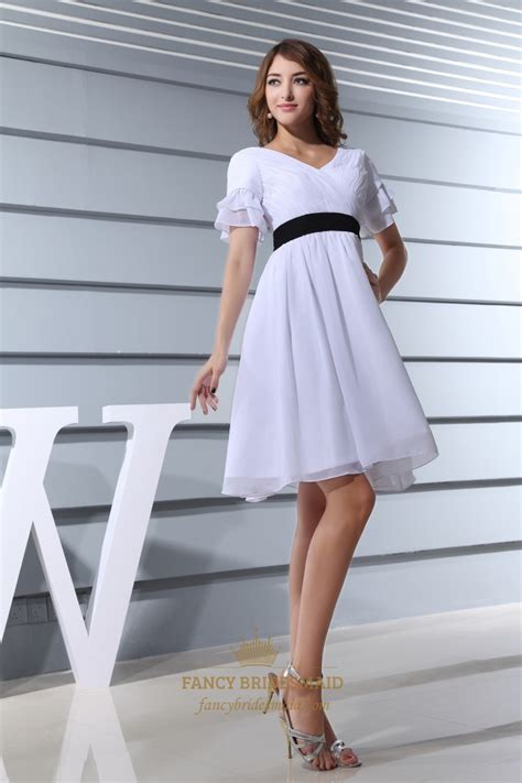 white cocktail dress with black belt white sleeve